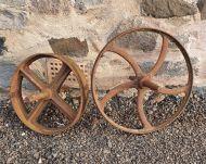 Two Antique Cast Iron Decorative Wheels